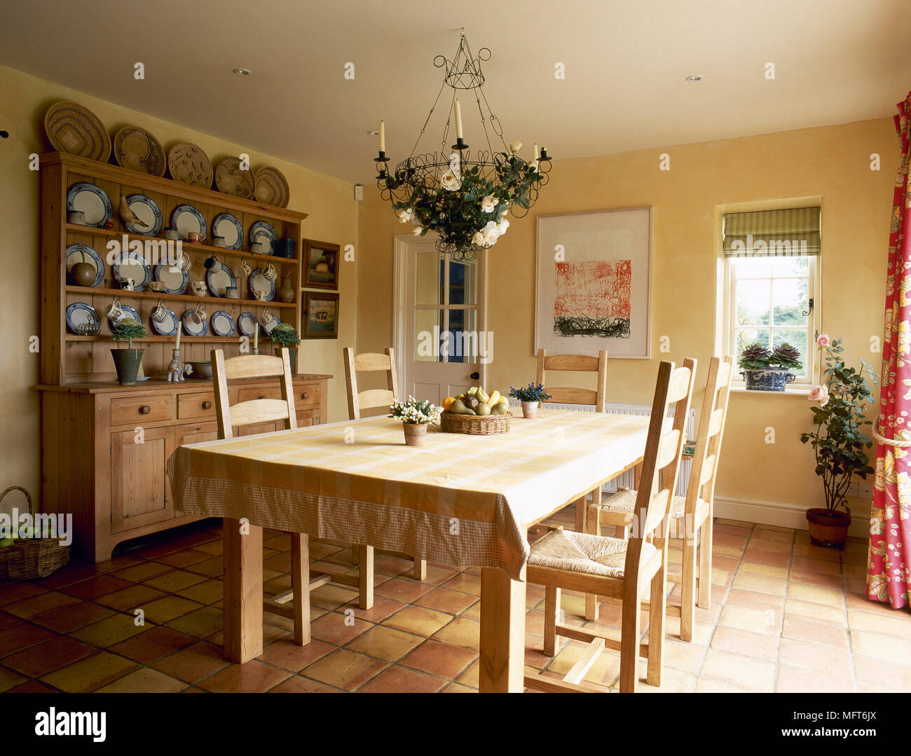 Country, yellow dining room with wooden buffet and hutch ...