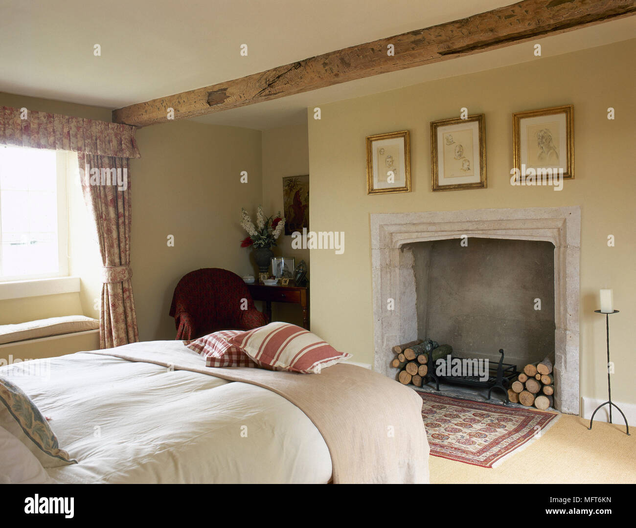 Country cottage bedroom with a beamed ceiling, stone ...