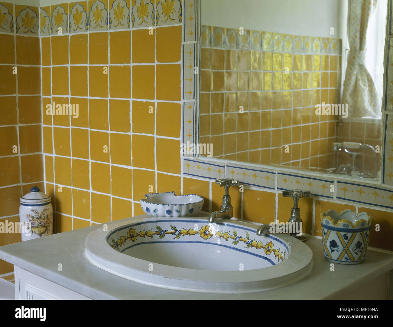 Country Bathroom Detail Yellow Tiles Ceramic Decorated Washbasin Set In Marble Top Interiors Bathrooms Sinks Stock Photo Alamy