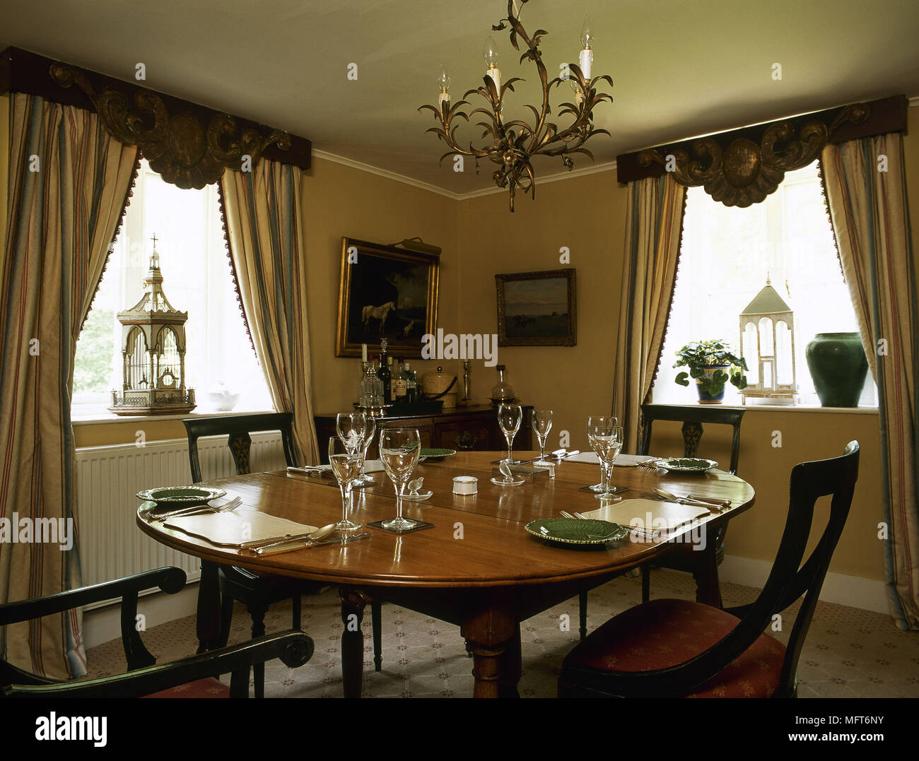 Traditional dining room gold striped curtains pelmets oval table ...