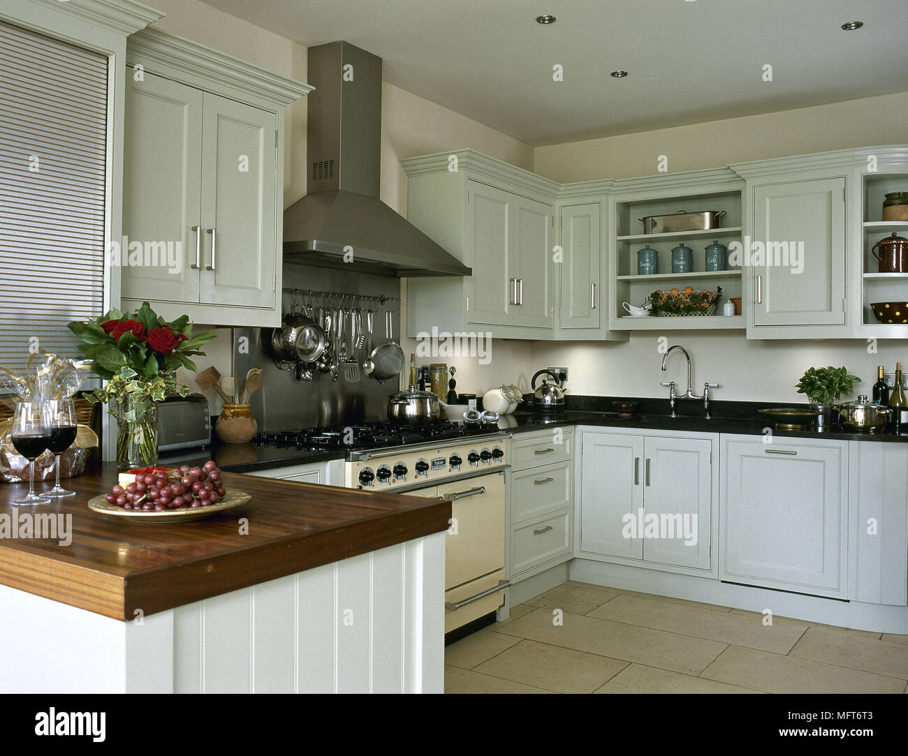 Cooker hood over range oven in contemporary country style kitchen