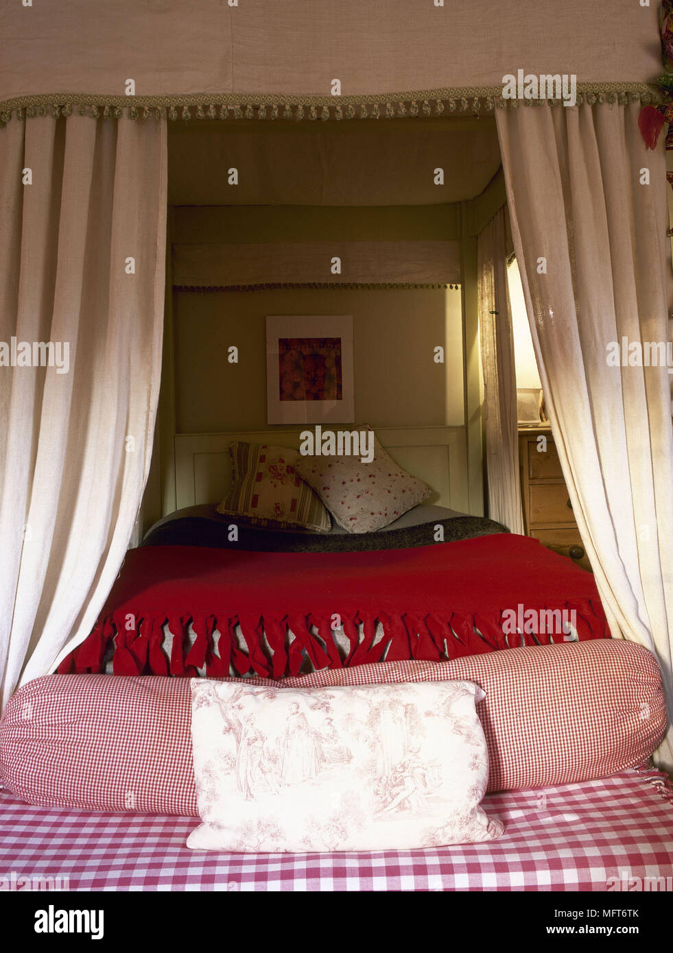 traditional bedroom detail four poster bed curtain canopy red bed cover check fabric bolster interiors bedrooms