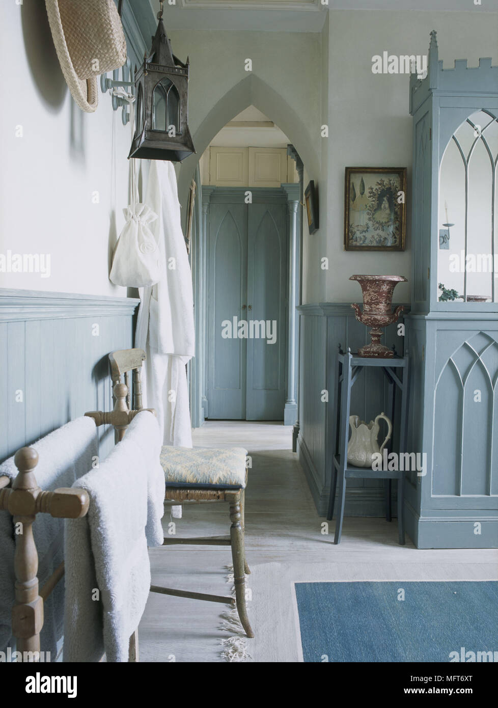 A detail of a traditional country blue bathroom painted gothic