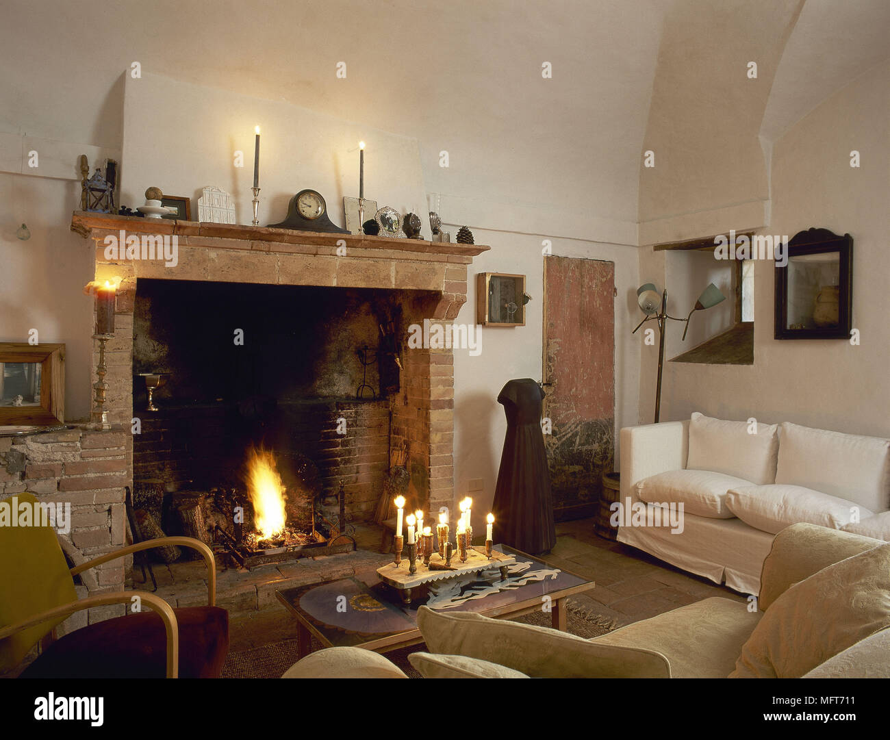 Rustic country sitting room brick fireplace open fire sofa ...
