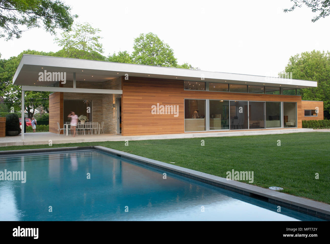 Exterior Of New Build Single Storey House With Swimming Pool In The ...