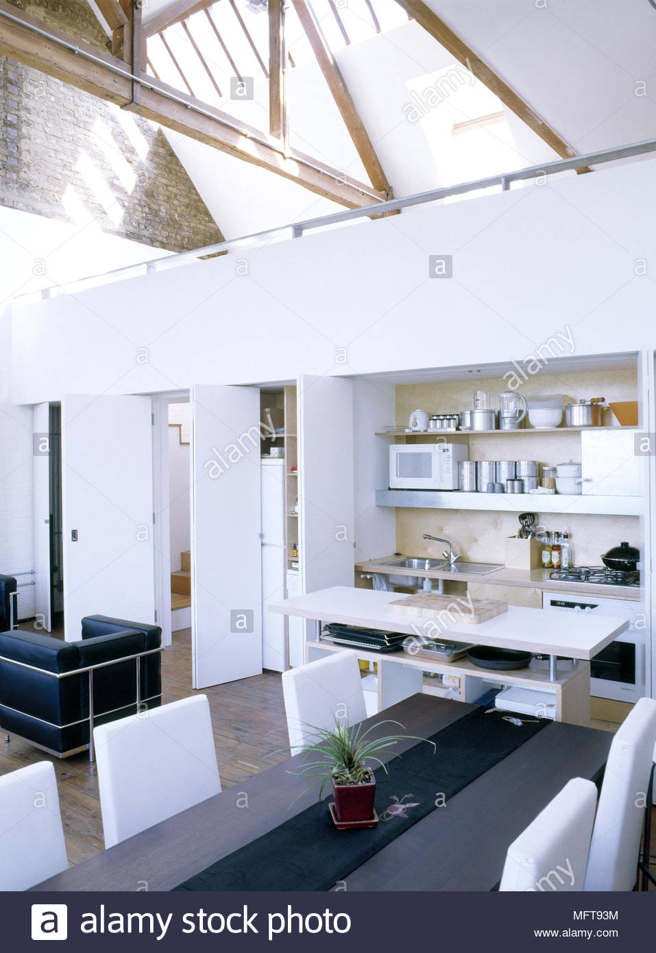 Open plan living dining room and kitchen small kitchen contained within a white wall cupboard & Open plan living dining room and kitchen small kitchen contained ...