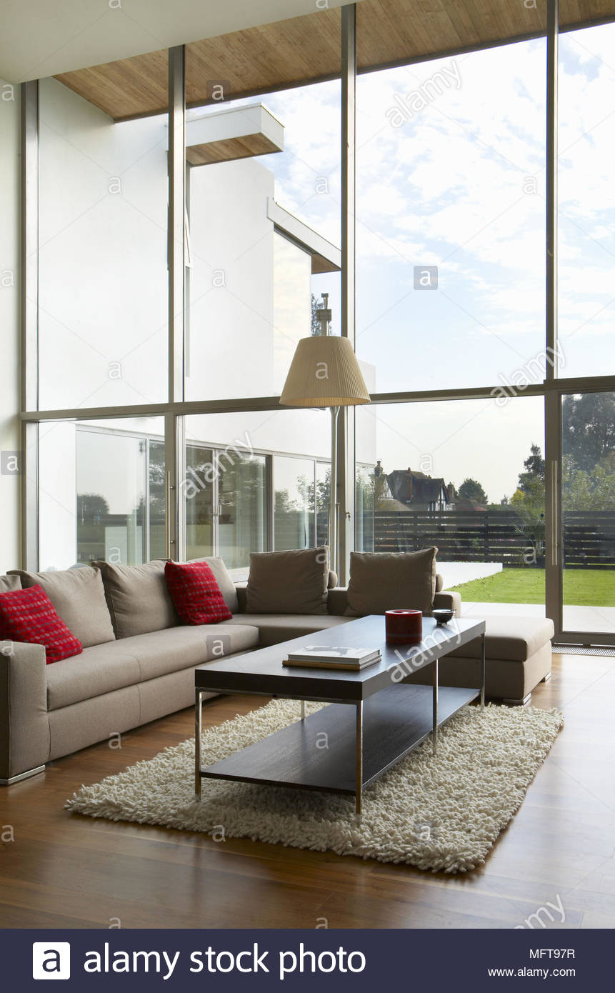 Seating arranged around coffee table in contemporary sitting room ...