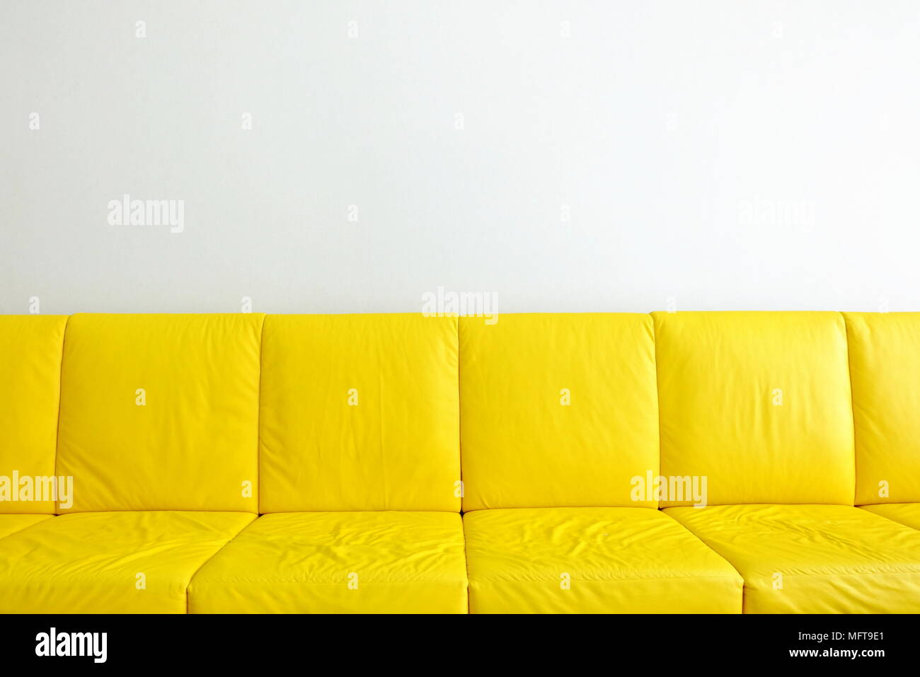 Yellow Sofas With White Wall Background.