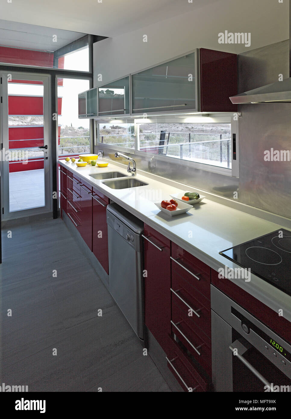 Double Sink Set In Worktop In Modern Kitchen With Red Units Stock