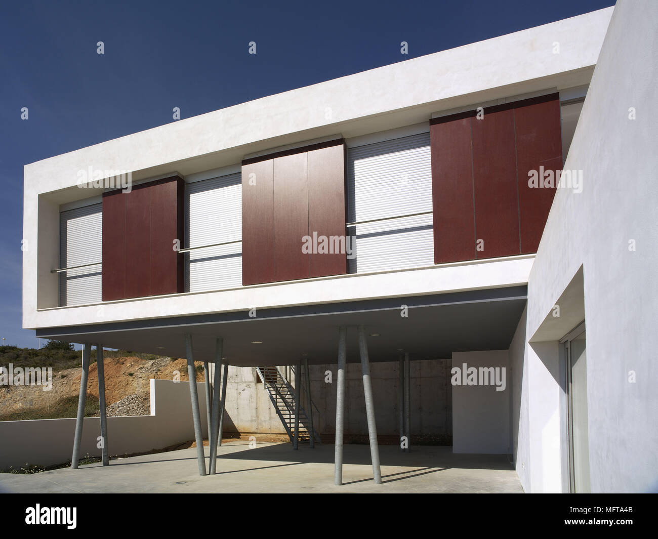 Exterior of new build white house on stilts Stock Photo