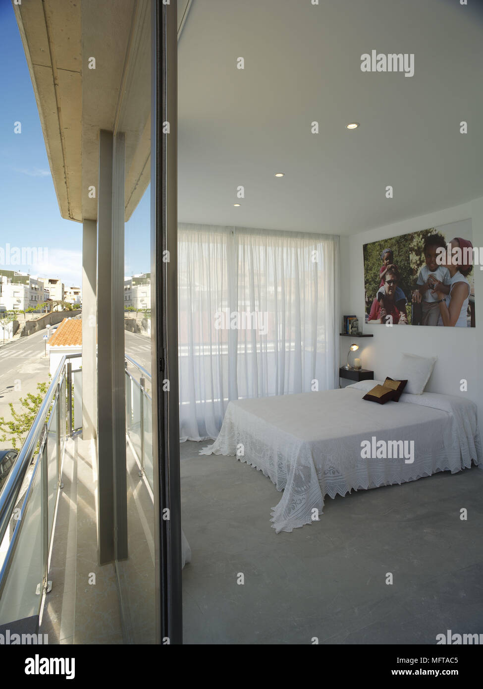 View Of Double Bed In Bedroom From Outside Sliding Door Stock Photo