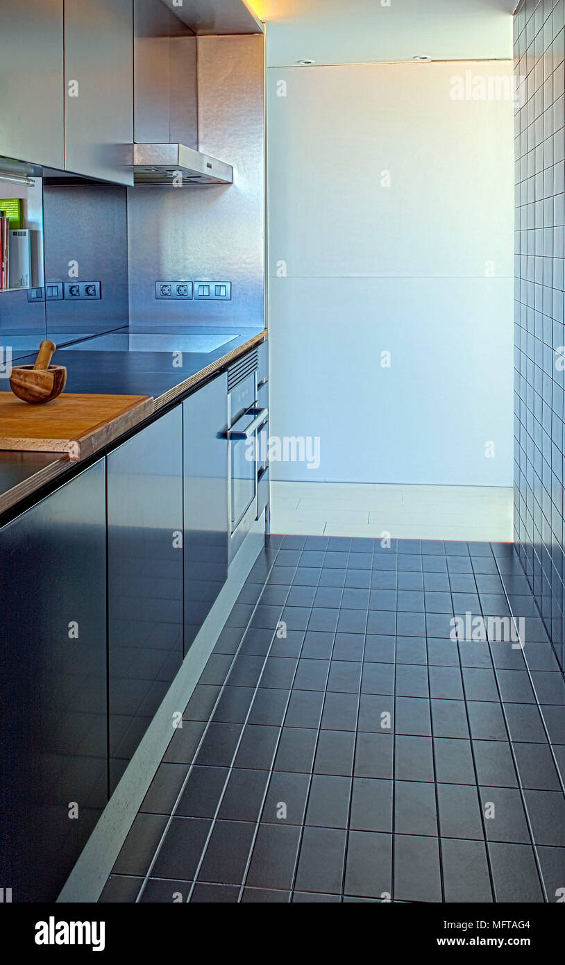 Modern narrow kitchen with blue tiled wall and floor Stock Photo ...