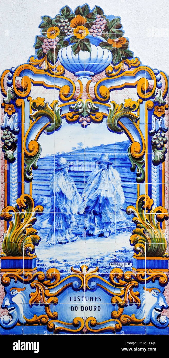 Traditional blue tiles (Azulejos) showing the work related with the Port Wine. Railway station of Pinhão, Douro region. A Unesco World Heritage Site,  - Stock Image