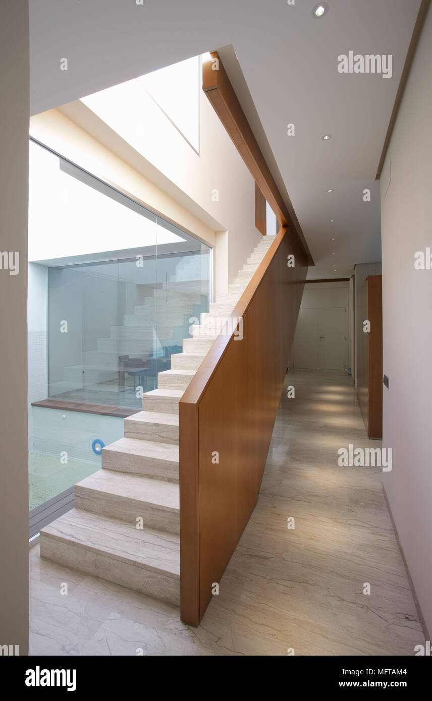 Contemporary Staircase With Marble Steps And Wooden Banister