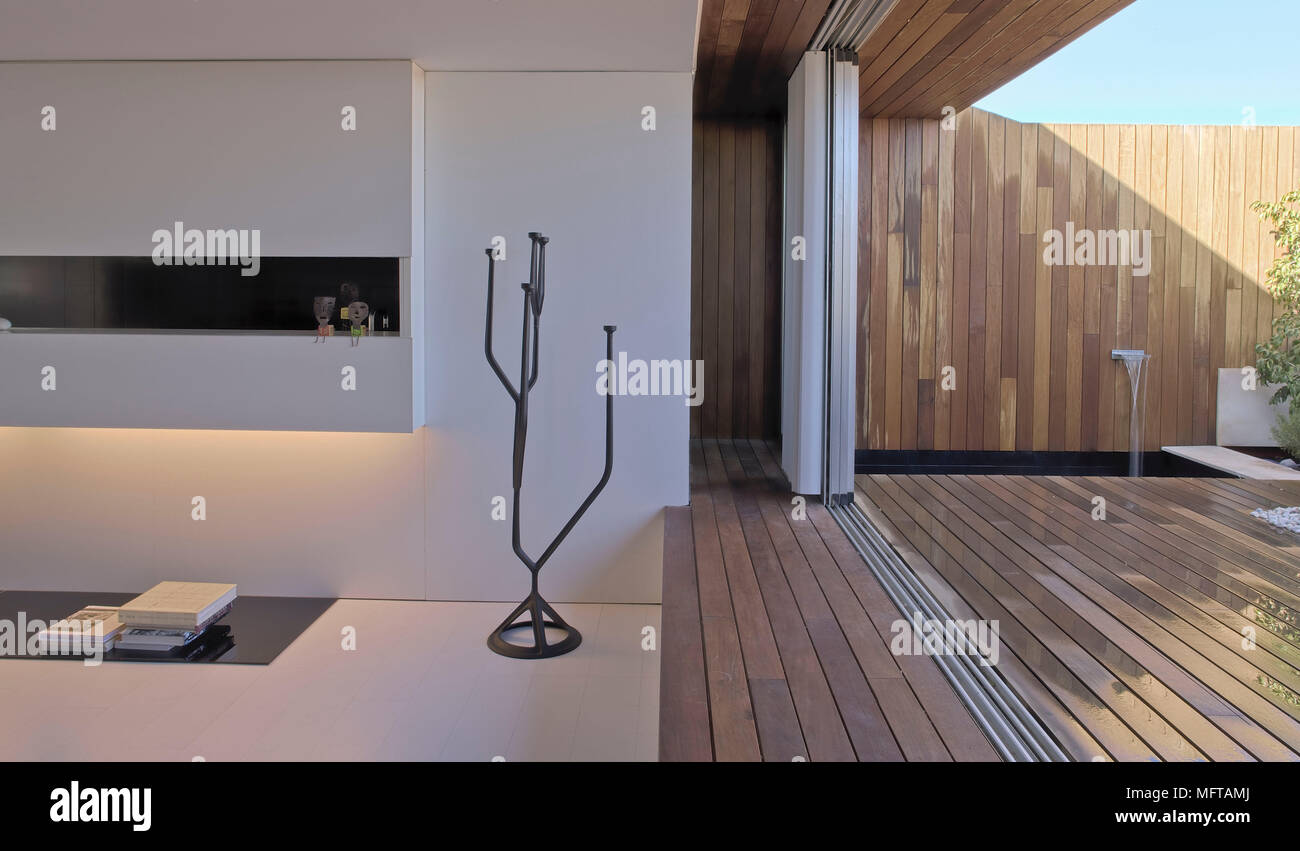 Concertina door folded open between modern room and decked area outside - Stock Image & Concertina Door Stock Photos \u0026 Concertina Door Stock Images - Alamy