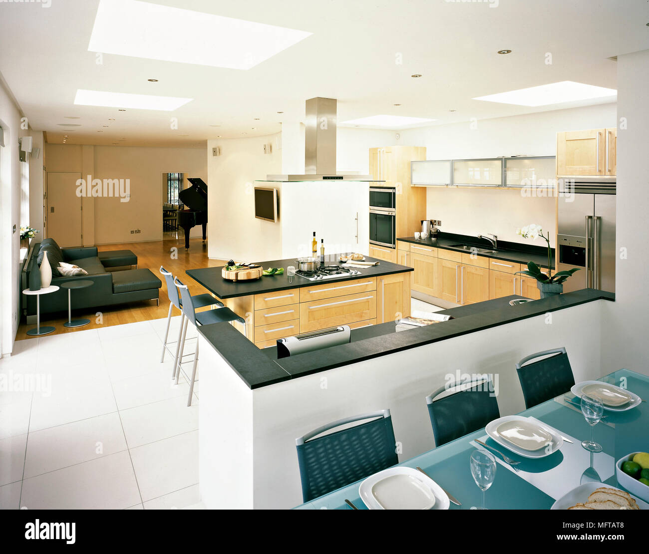 Open Plan Kitchen And Dining Area With Table Breakfast Bar Central Island