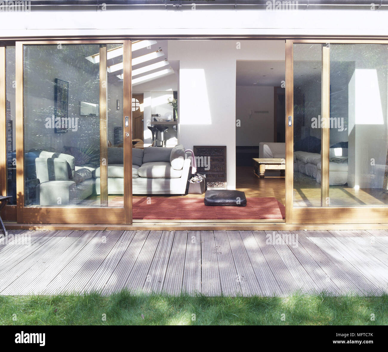 Exterior Of A Modern House With Open Sliding Glass Doors To A