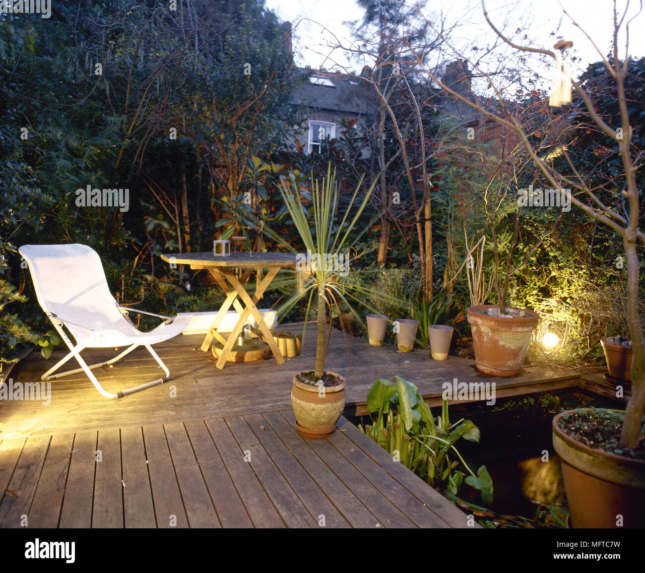 deck accent lighting. Modern Backyard Deck With Accent Lighting, Outdoor Furniture, And Potted Plants Lighting F