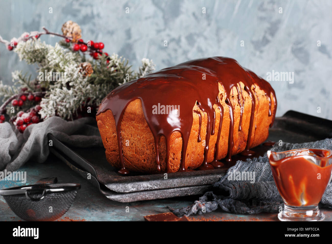 homemade chocolate bread with melted chocolate, in New Year's decorations - Stock Image