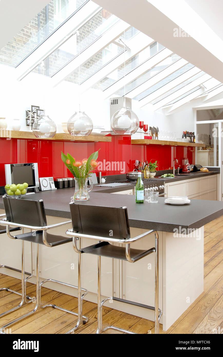 Miraculous Bar Stools At Breakfast Bar In Modern Spacious Kitchen Stock Machost Co Dining Chair Design Ideas Machostcouk
