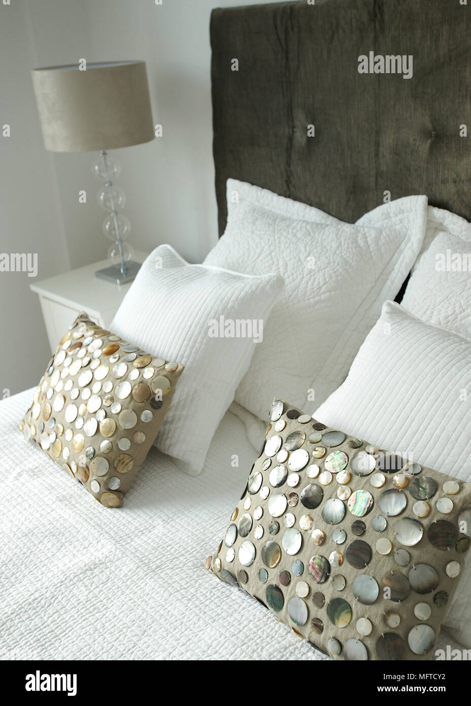 Avalon Cuscini.Textured Cushions On Double Bed With Upholstered Headboard Stock