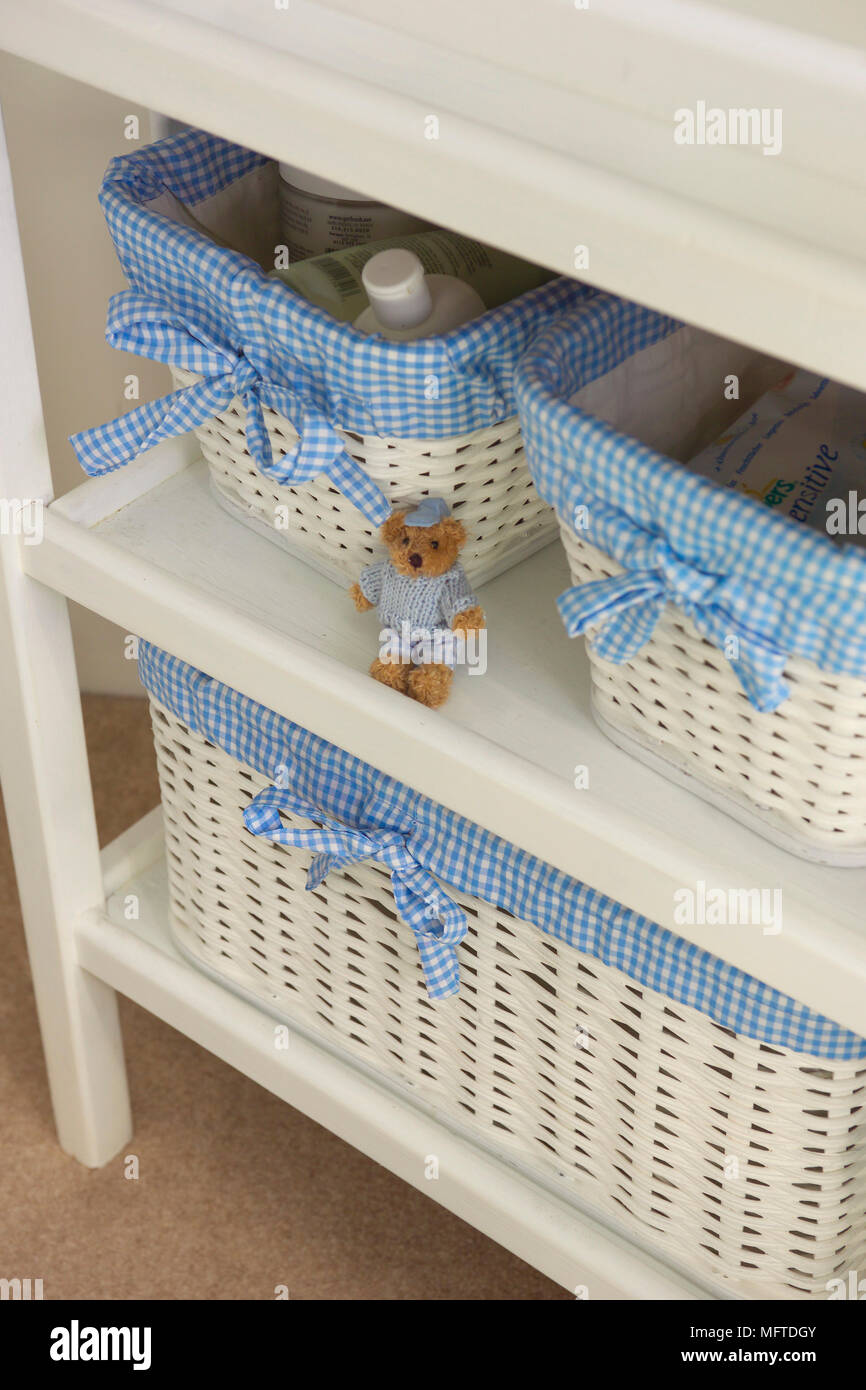Storage baskets with blue gingham fabric liner & Storage baskets with blue gingham fabric liner Stock Photo ...