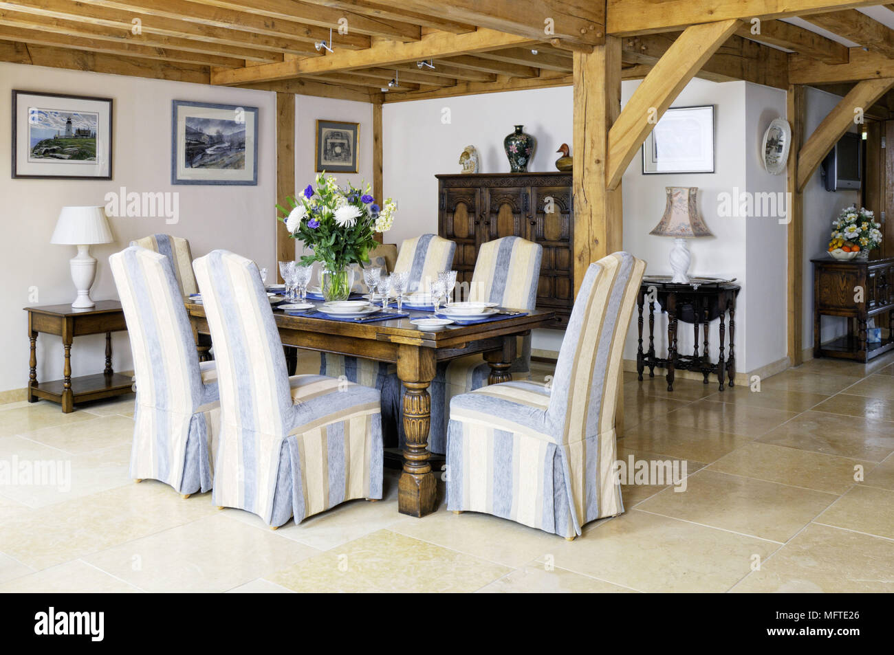 Upholstered Chairs At Wooden Table In Modern Country Style Dining Room