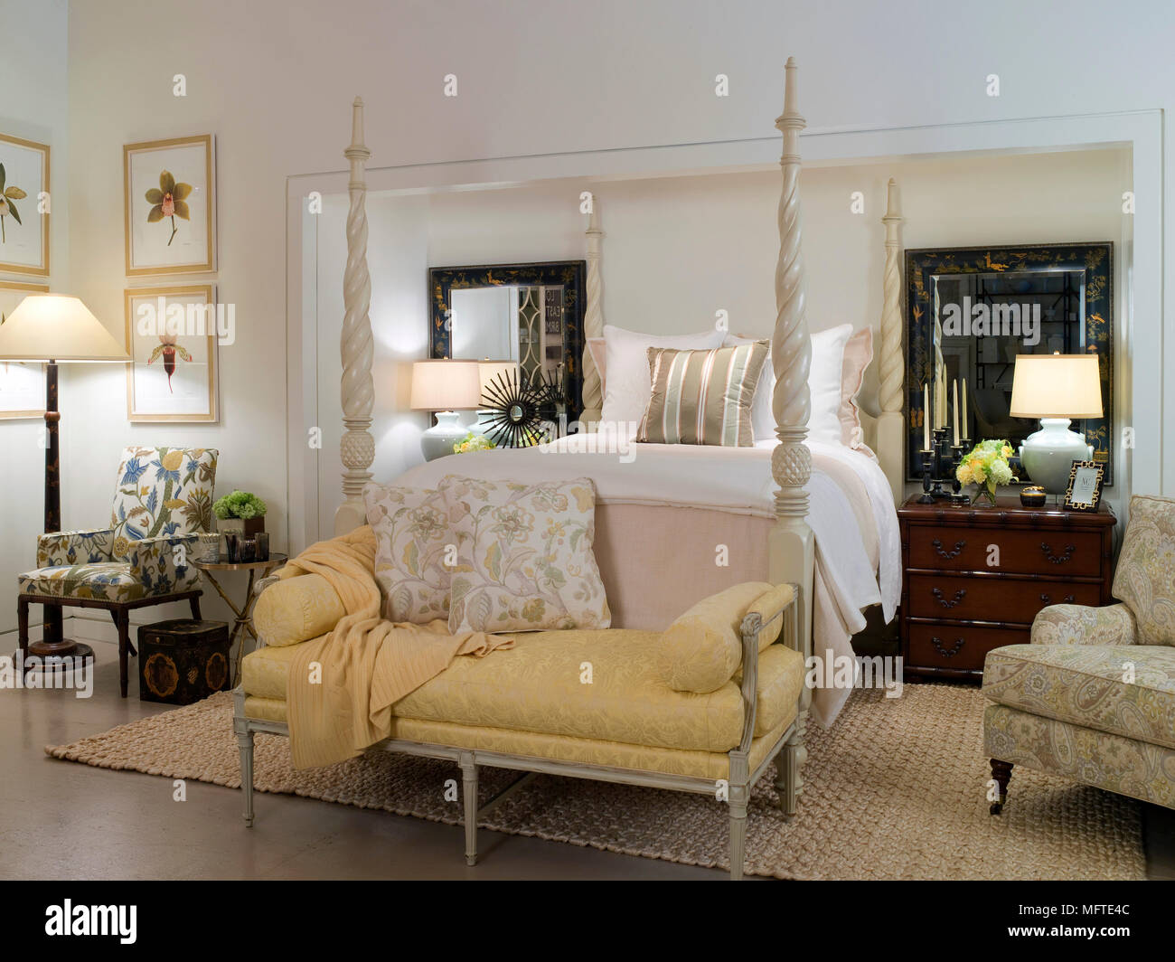 Settee At End Of Four Poster Bed In Traditional Style Bedroom Stock Photo Alamy