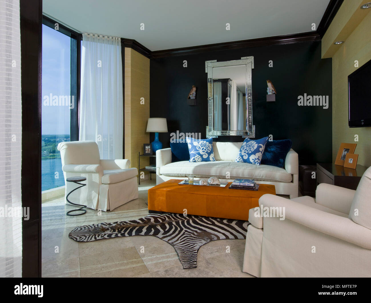 Upholstered Seating Around Ottoman In Modern Sitting Room