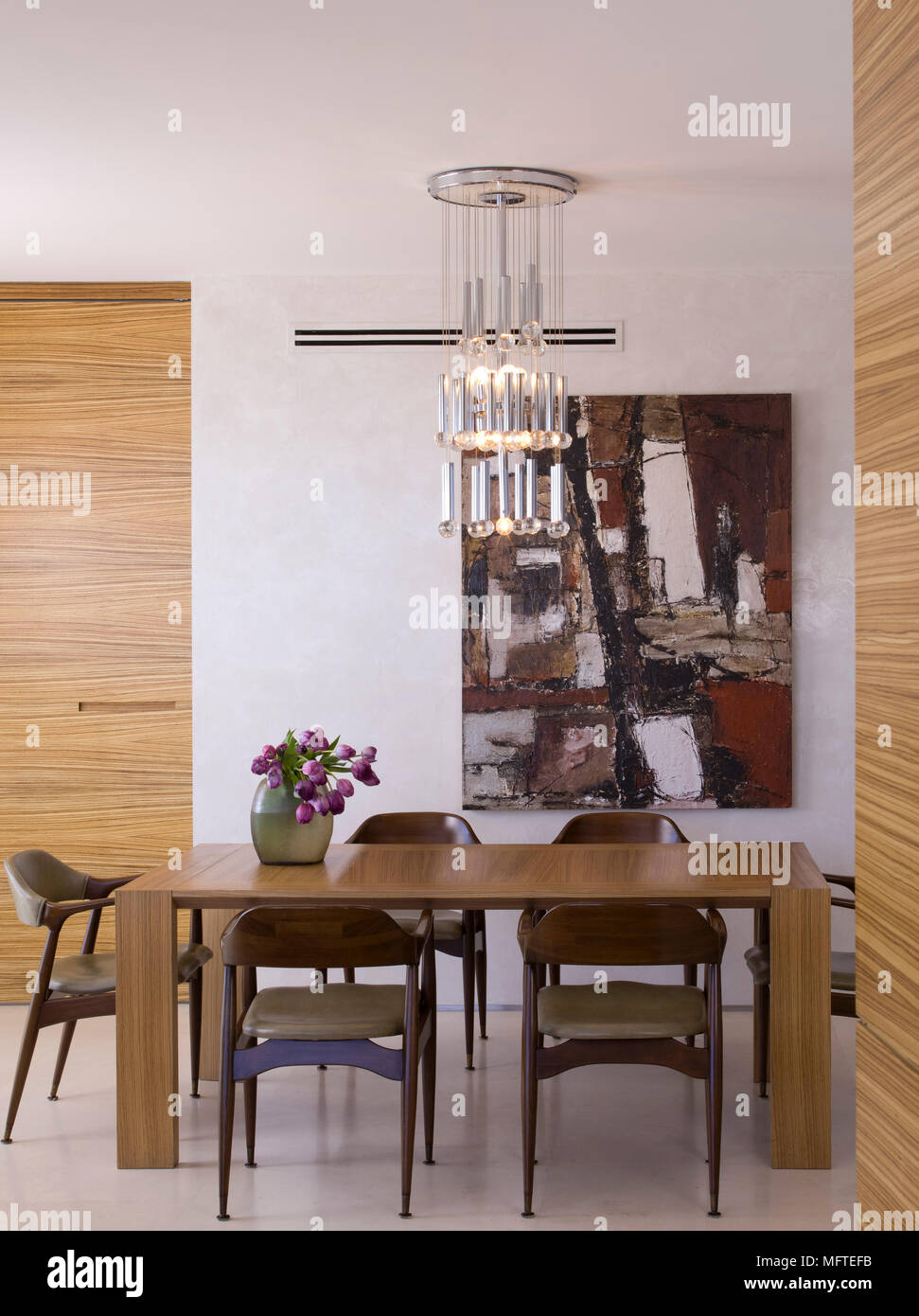 Pendant light above wooden table in modern dining room stock photo