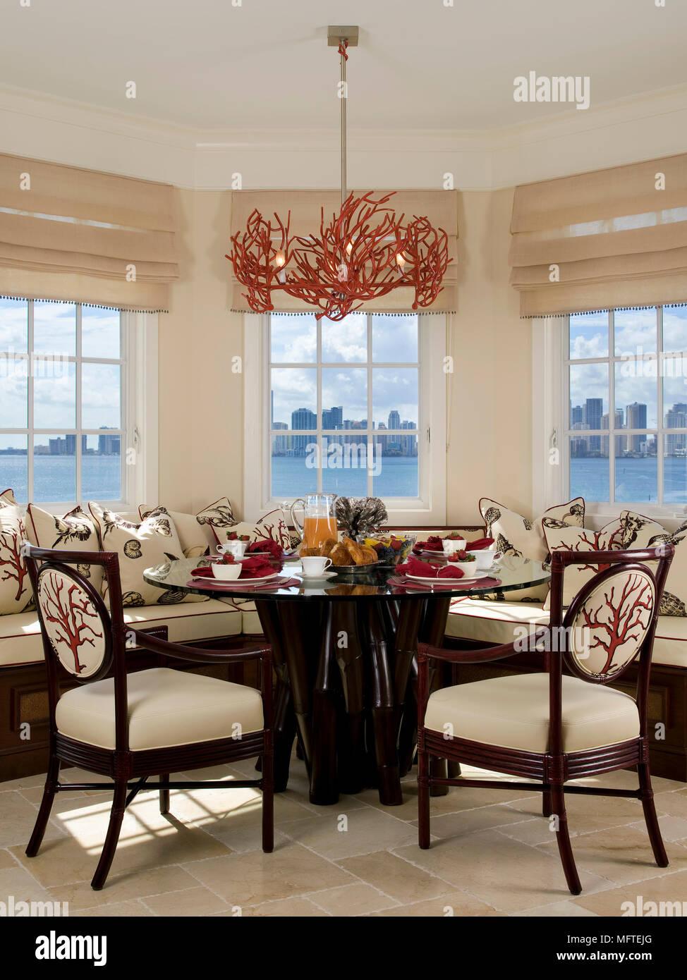 Ceiling light above round table set for dinner in modern dining ...