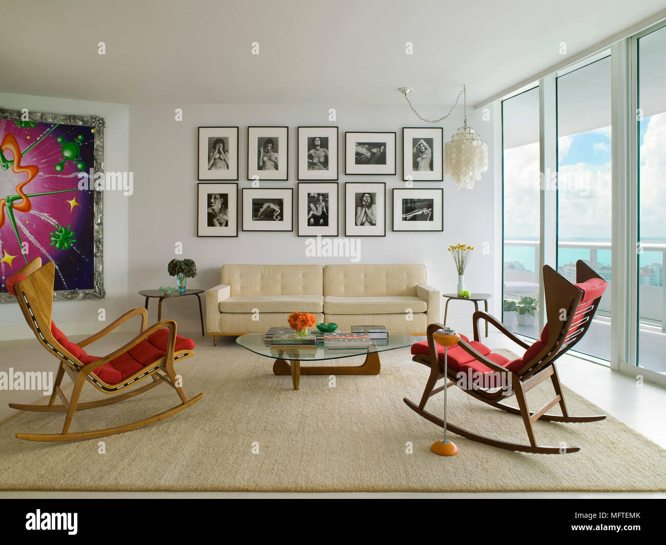Pair Of Rocking Chairs Facing Sofa In Modern Sitting Room With Isamu Noguchi Coffee Table Stock Photo Alamy