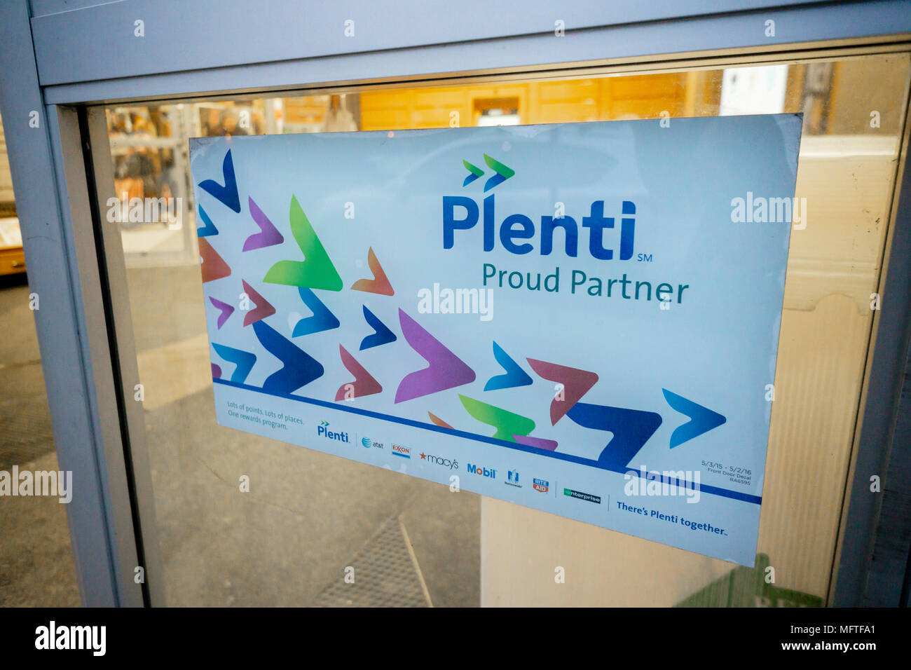 A sign in the entrance to a drugstore in New York informs consumers of the chain's participation in the American Express frequent shopper service, Plenti, seen on Tuesday, April 17, 2018. American Express announced that after the loss of some big brands and general malaise in the program Plenti will cease to operate on July 10 when all customers' Plenti points will expire. (© Richard B. Levine) - Stock Image