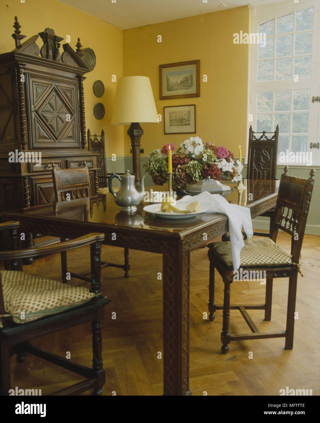 Traditional Dining Room Yellow And Pale Green Walls Table Chairs Cushions Ornate Carved Side Unit Interiors Rooms Colour Standard Lamp Lampshade Fram