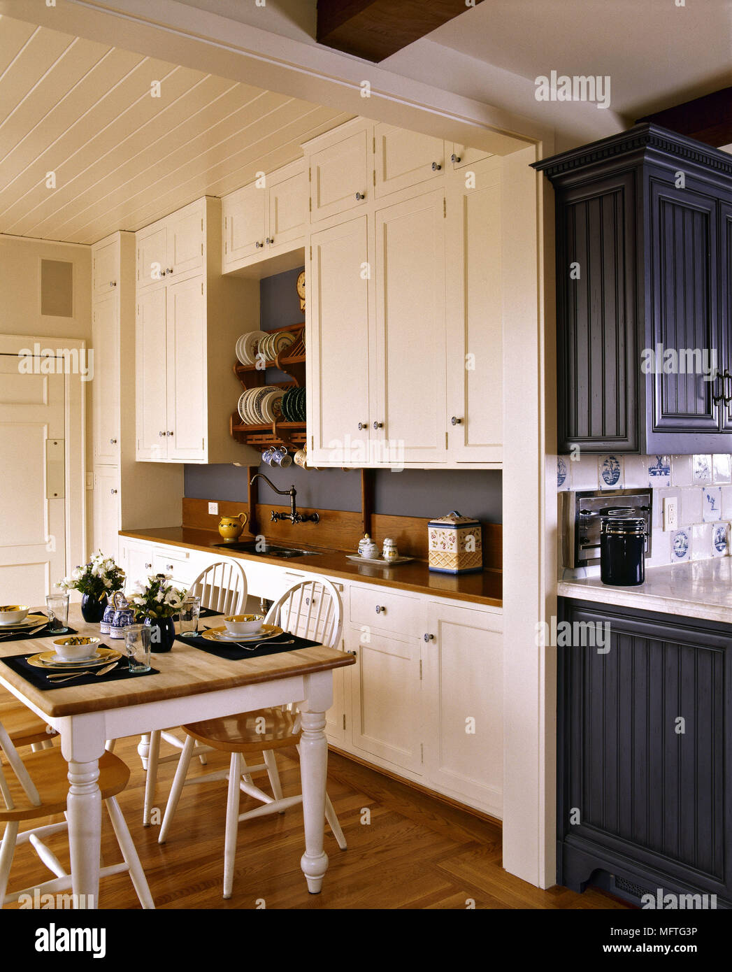 Country Style Kitchen With White Wooden Units And Tongue And - Country-style-kitchen