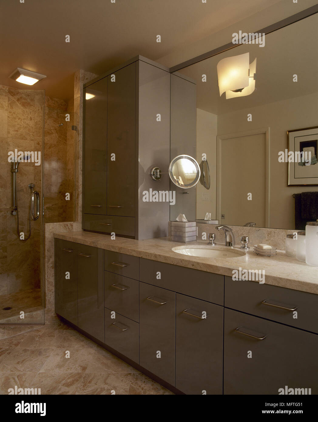 Modern bathroom detail washbasin set in cupboard unit shower cubicle ...