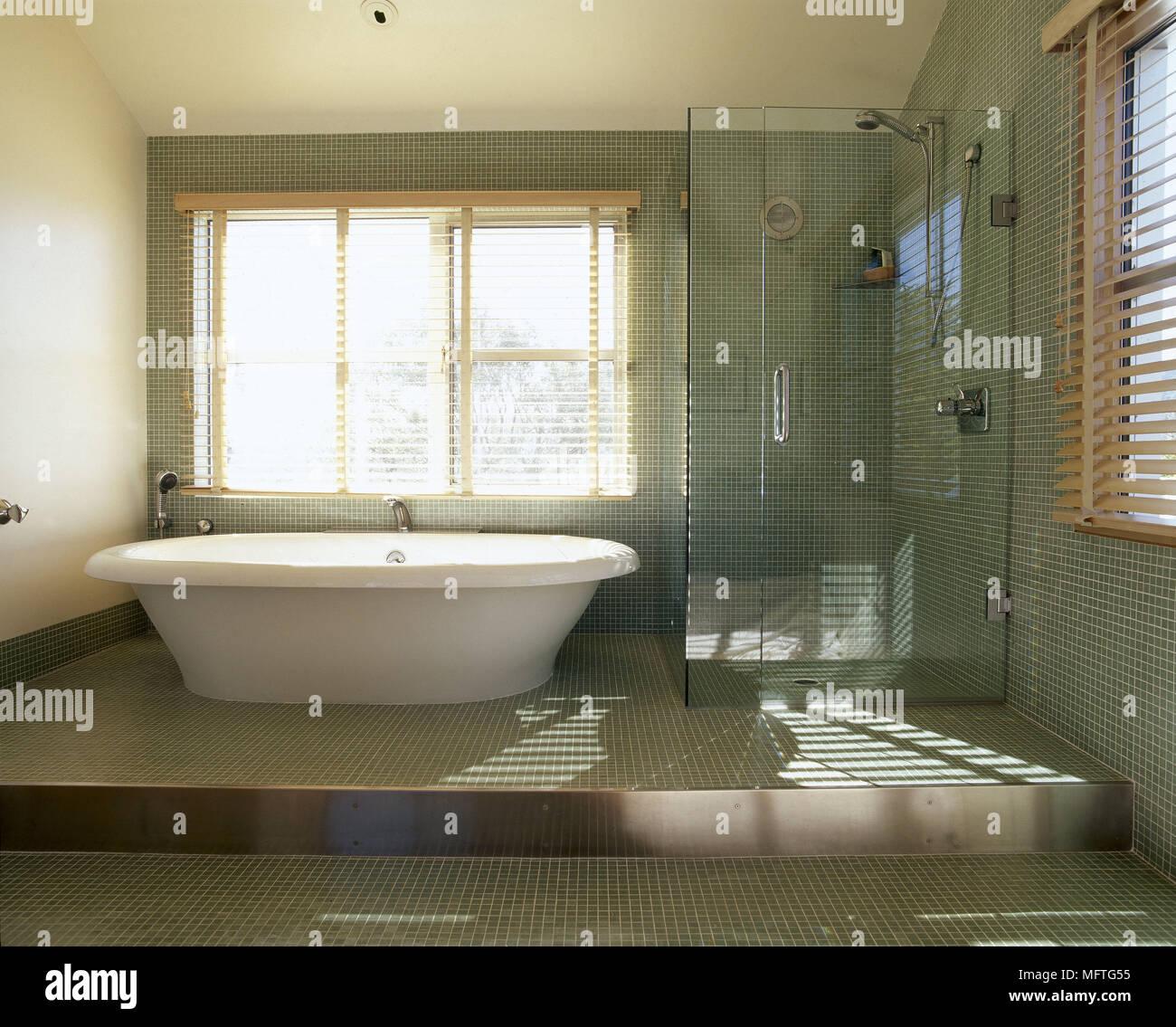 Modern bathroom free standing bath mosaic tiled flor walls shower ...