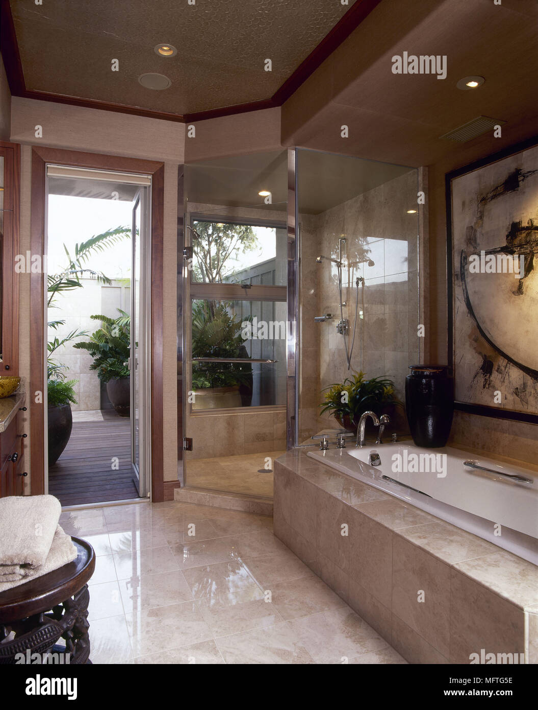 Modern bathroom marble tiled bath shower enclosure interiors ...