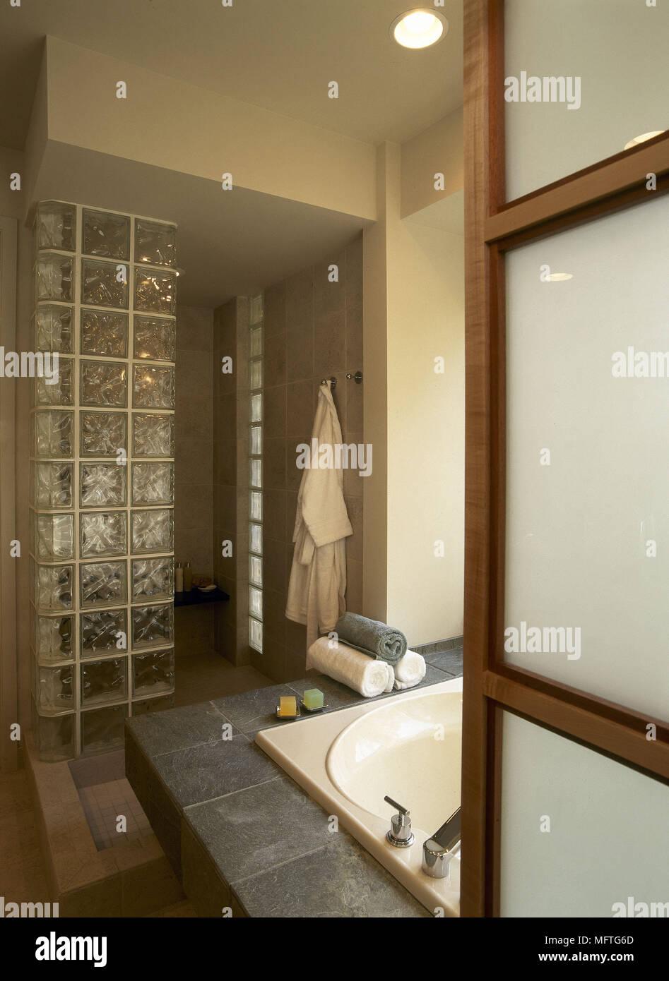 Modern bathroom with sunken bath and slate surround USA Stock Photo ...