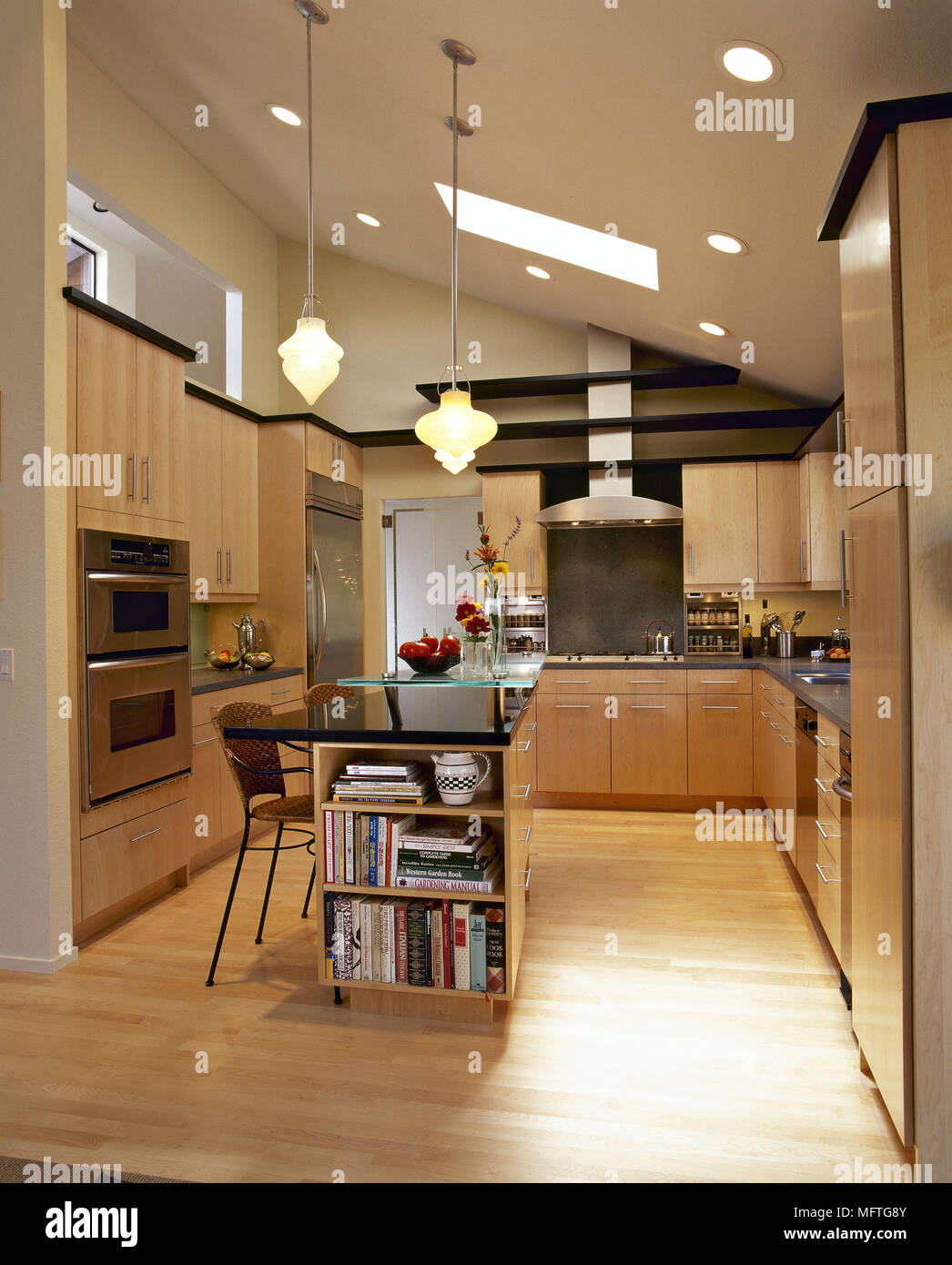 Cuisine Moderne Ilot Central modern kitchen with wood units and central island with