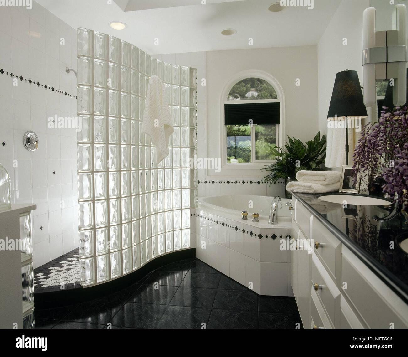 Modern white bathroom corner bath walk in shower glass brick shower ...