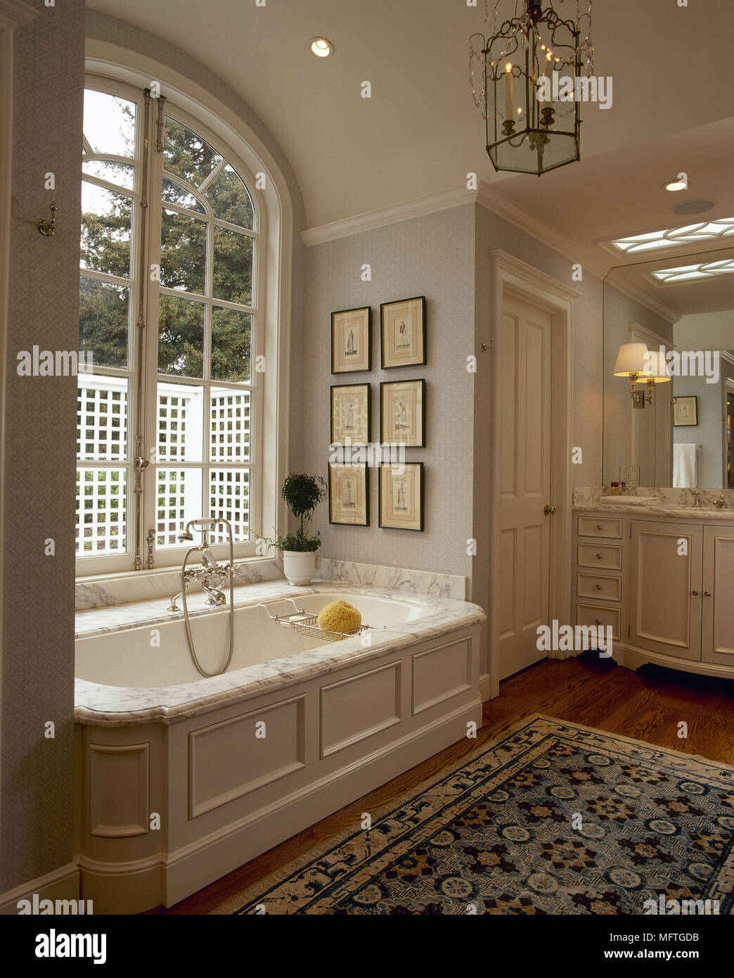 Traditional neutral bathroom bath marble surround arched window ...