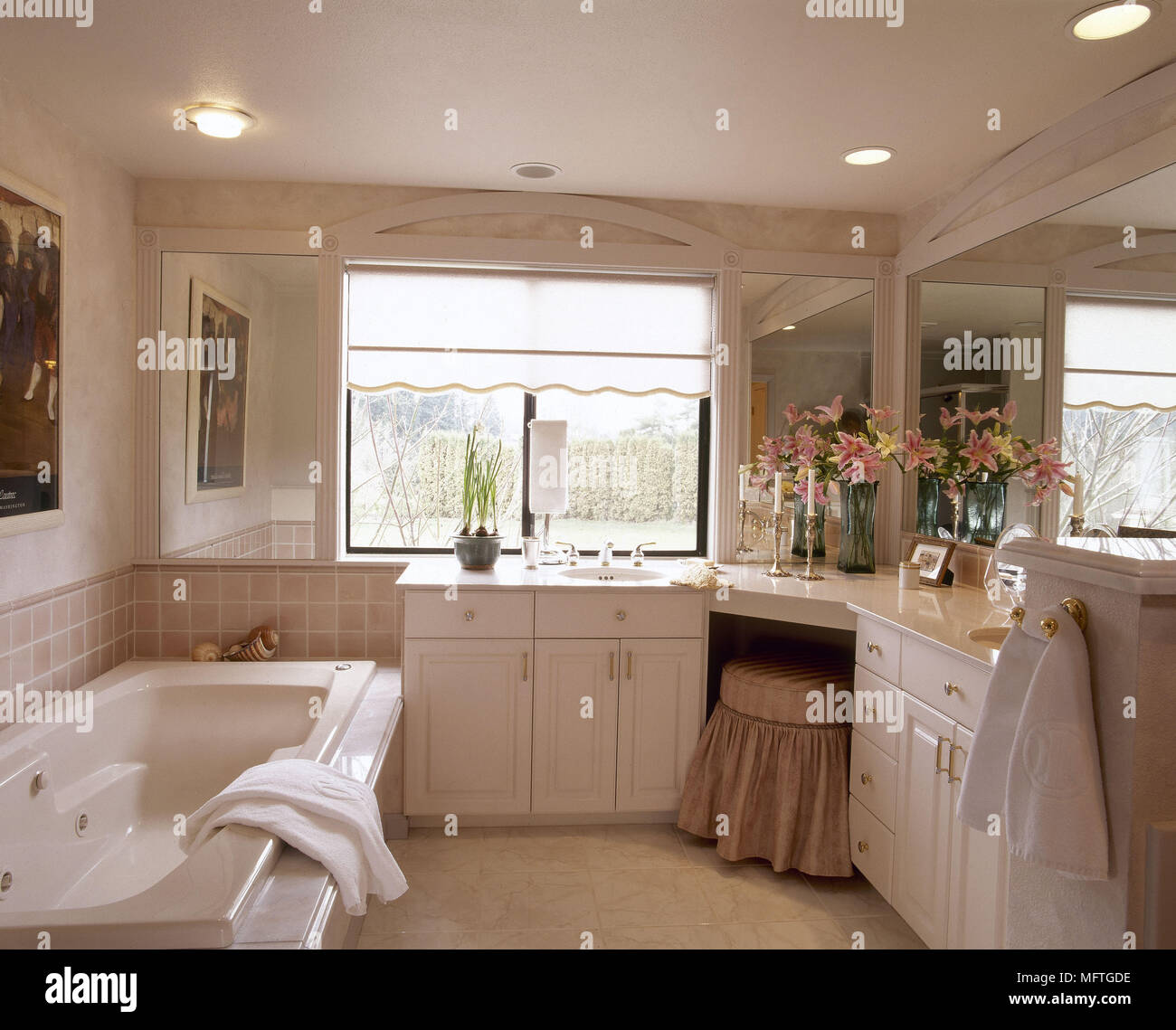 Traditional neutral bathroom built in dressing table whirlpool bath ...