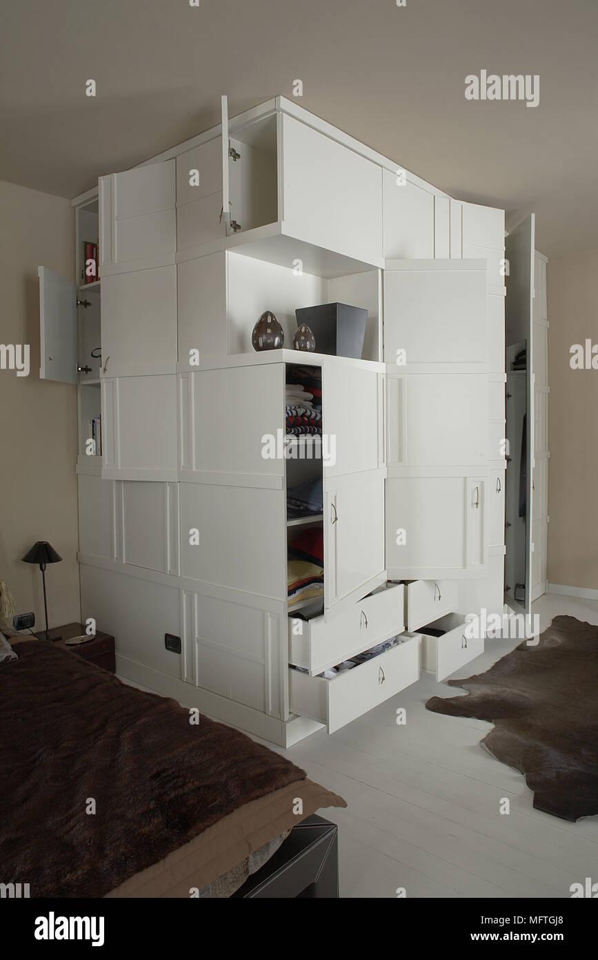 Multi drawer storage unit in corner of modern bedroom Stock ...