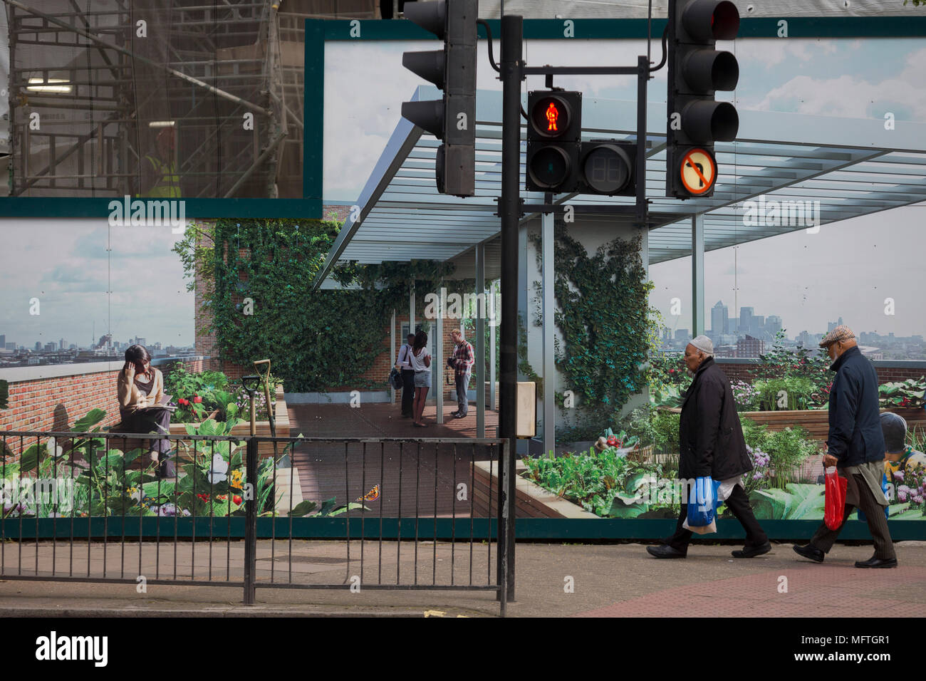 Passers-by and a marketing hoarding for the newest delvelopment at Elephant and Castle called Elephant Park, on 25th April 2018, in London, England. - Stock Image