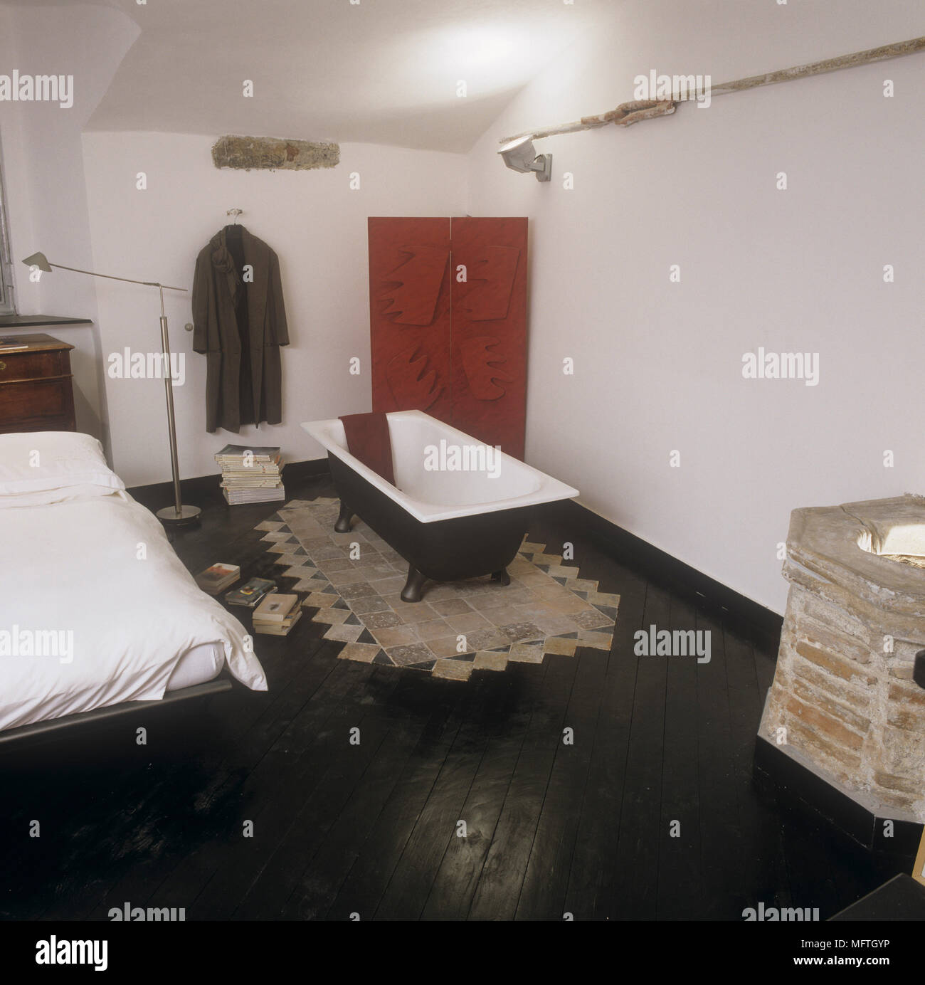 Bedroom with double bed and freestanding bathtub Stock Photo ...