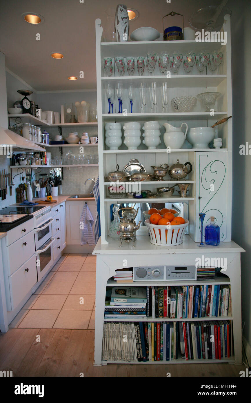 Glassware And Tableware In Freestanding Shelving Unit In Kitchen