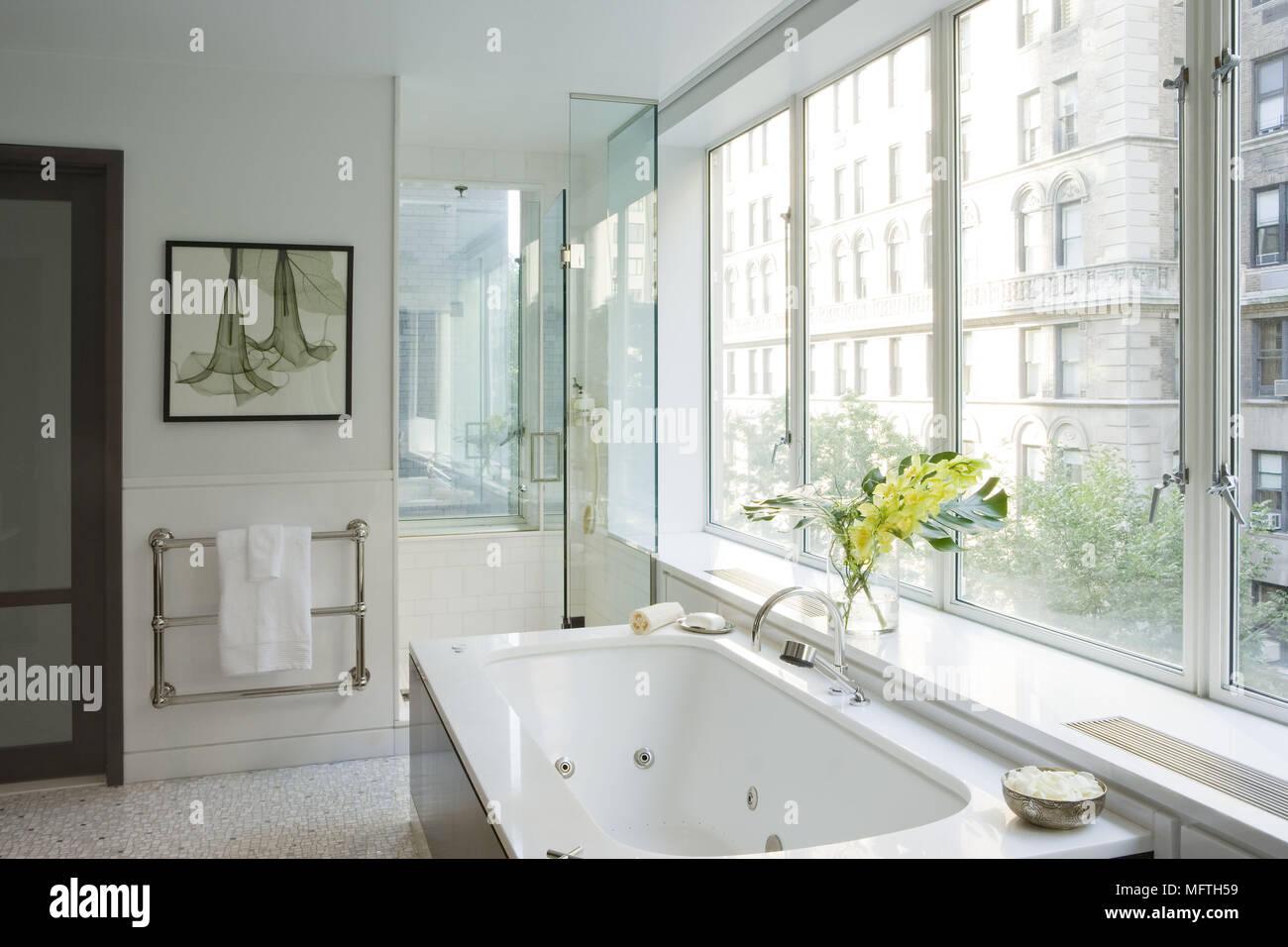 Bathtub under window in modern bathroom with shower cubicle Stock ...