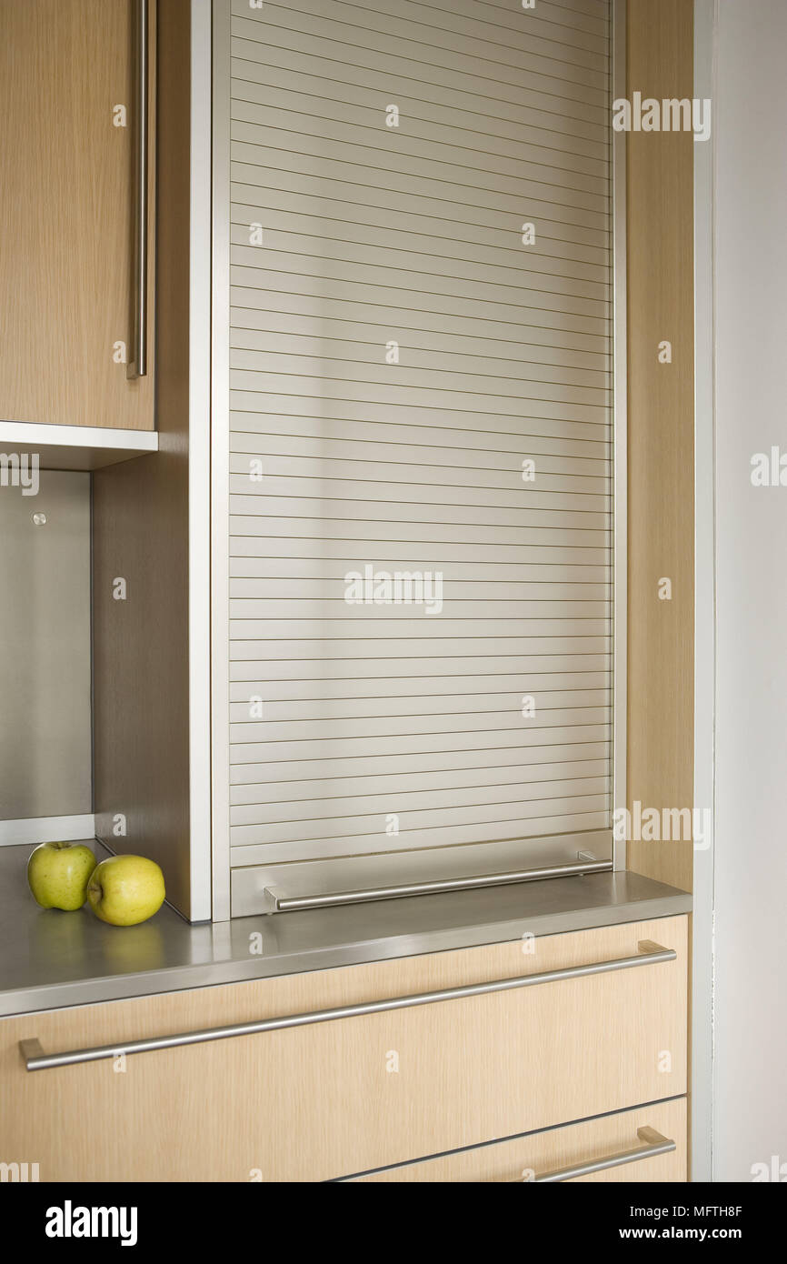 Fitted Unit With Roller Shutter In Modern Kitchen Stock