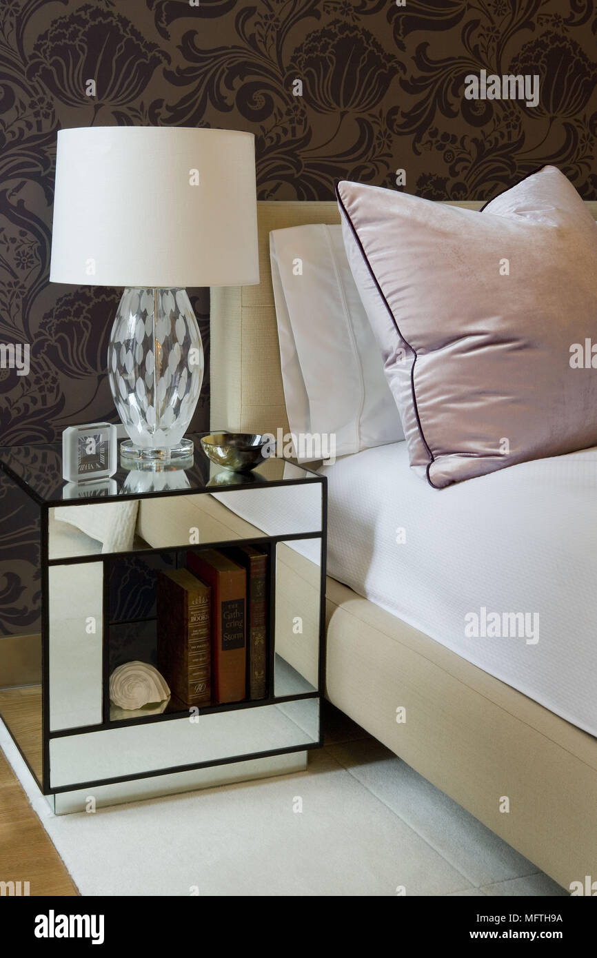 Glass Lamp On Mirrored Bedside Cabinet Next To Double Bed In